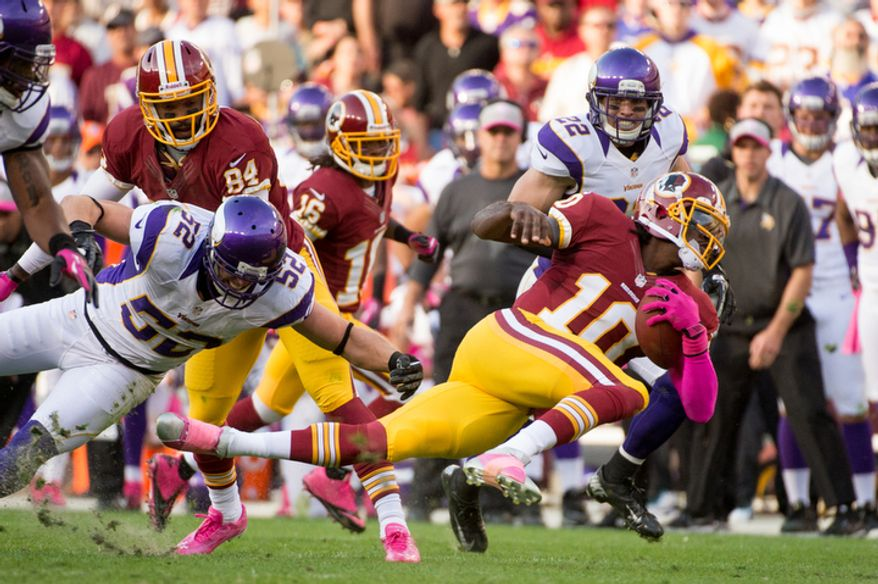Washington Redskins quarterback Robert Griffin III (10) rushes in the first quarter as the Washington Redskins play the Minnesota Vikings. (Andrew Harnik/The Washington Times)