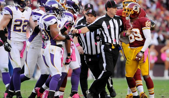 Washington Redskins wide receiver Santana Moss (89) is separated from the Minnesota Vikings after a first quarter play at FedEx Field. (Preston Keres/Special to The Washington Times)