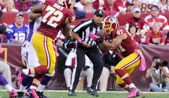 Washington Redskins linebacker Lorenzo Alexander (97) intercepts a pass in the second quarter setting up a Redskins touchdown at FedEx Field. (Preston Keres/Special to The Washington Times)