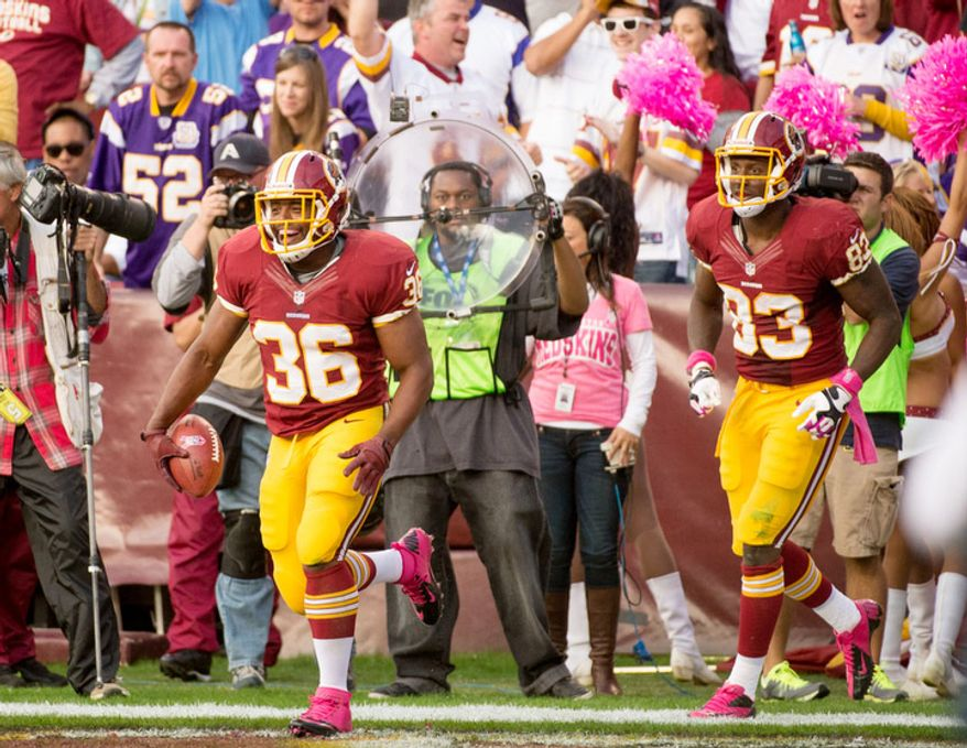 Washington Redskins fullback Darrel Young (36) scores on a six yard pass in the second quarter to put the Washington Redskins up 17-9 as the Washington Redskins play the Minnesota Vikings at FedEx Field. (Andrew Harnik/The Washington Times)
