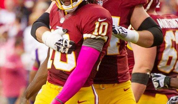 Washington Redskins tackle Tyler Polumbus (74) celebrates with Washington Redskins quarterback Robert Griffin III (10) after he scores on a 7 yard touchdown run in the third quarter to put the Washington Redskins up 24-9 as the Washington Redskins play the Minnesota Vikings2. (Andrew Harnik/The Washington Times)
