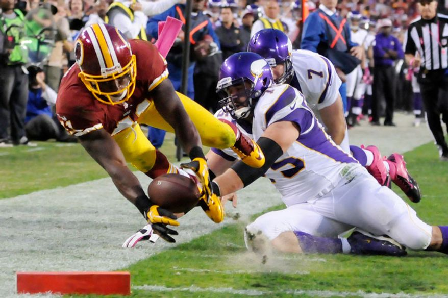 Washington Redskins free safety Madieu Williams (41) returns an interception 24 yards for fourth quarter touchdown in front of Minnesota Vikings tackle Matt Kalil (75) and quarterback Christian Ponder (7) at FedEx Field. (Preston Keres/Special to The Washington Times)