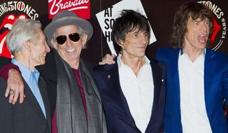 Charlie Watts (from left), Keith Richards, Ronnie Wood and Mick Jagger get together again to mark the 50th anniversary of the Rolling Stones' first performance. The band plans to return to the stage this year with four concerts, including two in the United States. (AP Photo)