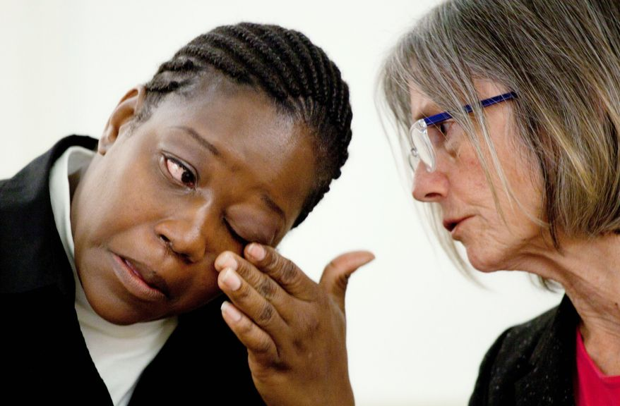 Rubbie McCoy, a plaintiff in a lawsuit filed against Morgan Stanley, describes her situation in New York on Monday as her attorney Elizabeth Cabraser looks on. Ms. McCoy is part of a suit that claims that Morgan Stanley discriminated against black homeowners and violated federal civil rights laws. She said her mortgage broker falsified her loan application in 2006. (Associated Press)