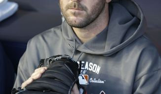 Detroit Tigers starting pitcher Justin Verlander  sits in the dugout before Game 1 of the American League championship series against the New York Yankees Saturday, Oct. 13, 2012, in New York. (AP Photo/Paul Sancya )