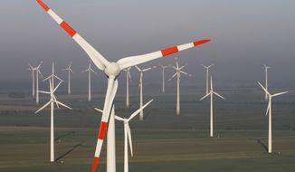 **FILE** Wind turbines produce green energy in Nauen near Berlin on Oct. 12, 2012. (Associated Press)