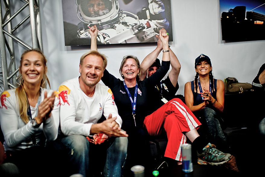 In this photo provided by Red Bull, family members and friends of pilot Felix Baumgartner celebrate his successful jump in Roswell, N.M., on Oct. 14, 2012. Baumgartner came down safely in the eastern New Mexico desert minutes about nine minutes after jumping from his capsule 128,097 feet, or roughly 24 miles, above Earth (Associated Press/Red Bull Stratos, Joerg Mitter)