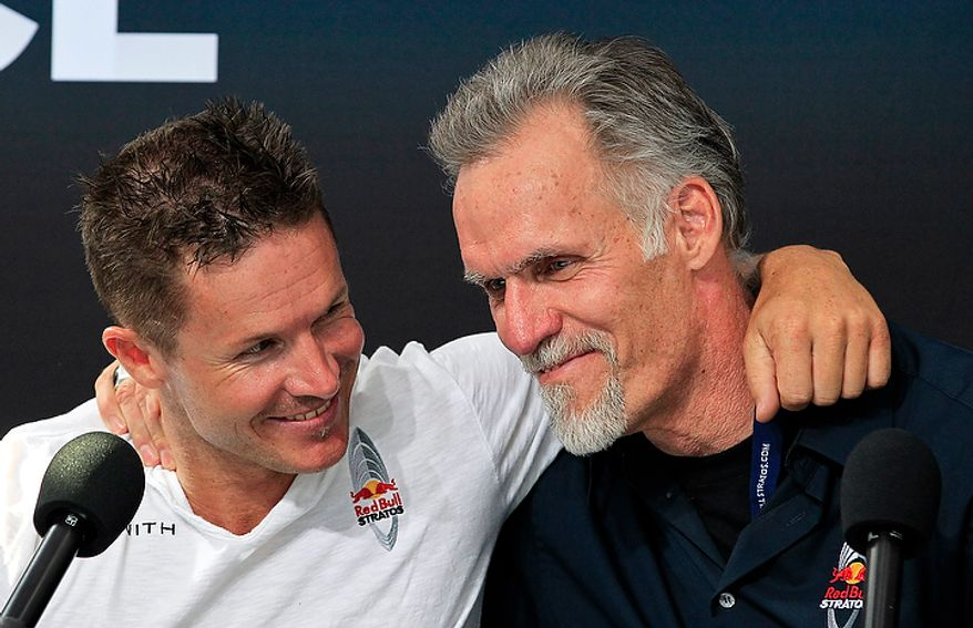 Felix Baumgartner (left), of Austria, hugs Art Thompson, technical project director, on Oct. 14, 2012, in Roswell, N.M., after Baumgartner successfully jumped from a space capsule lifted by a helium balloon at a height of just over 128,000 feet above the Earth's surface. (Associated Press)
