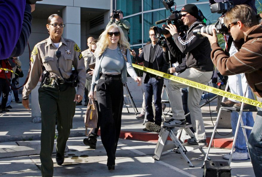 Actress Lindsay Lohan leaves Los Angeles Superior Court after a probation progress hearing on Tuesday, Jan. 17, 2012. (AP Photo/Reed Saxon)
