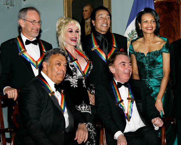 The 2006 Kennedy Center Honorees pose for a group photo with Secretary of State Condoleezza Rice at the State Department in Washington on Saturday, Dec. 2, 2006. From left to right are Steven Spielberg, Zubin Mehta, Dolly Parton, Smokey Robinson, Andrew Lloyd Webber and Miss Rice.  (AP Photo/J. Scott Applewhite)