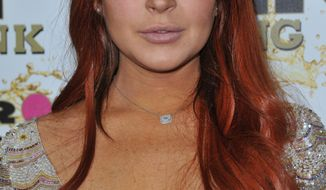 Lindsay Lohan attends the Mr. Pink Ginseng launch party at the Beverly Wilshire hotel in Beverly Hills, Calif., on Oct. 11, 2012. (Richard Shotwell/Invision/Associated Press)