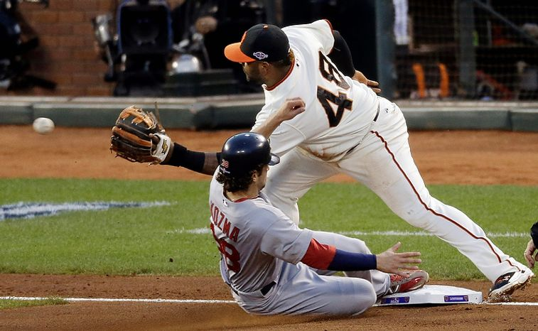 St. Louis Cardinals' Pete Kozma steals third as San Francisco Giants' Pablo Sandoval covers during the fourth inning of Game 1 of baseball's National League championship series Sunday, Oct. 14, 2012, in San Francisco. (AP Photo/Mark Humphrey)