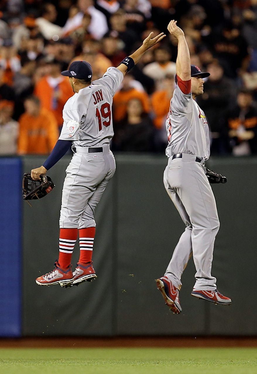 St. Louis Cardinals' Jon Jay (19) and Matt Holliday celebrate after Game 1 of baseball's National League championship series against the San Francisco Giants Sunday, Oct. 14, 2012, in San Francisco. The Cardinals won 6-4. (AP Photo/David J. Phillip)