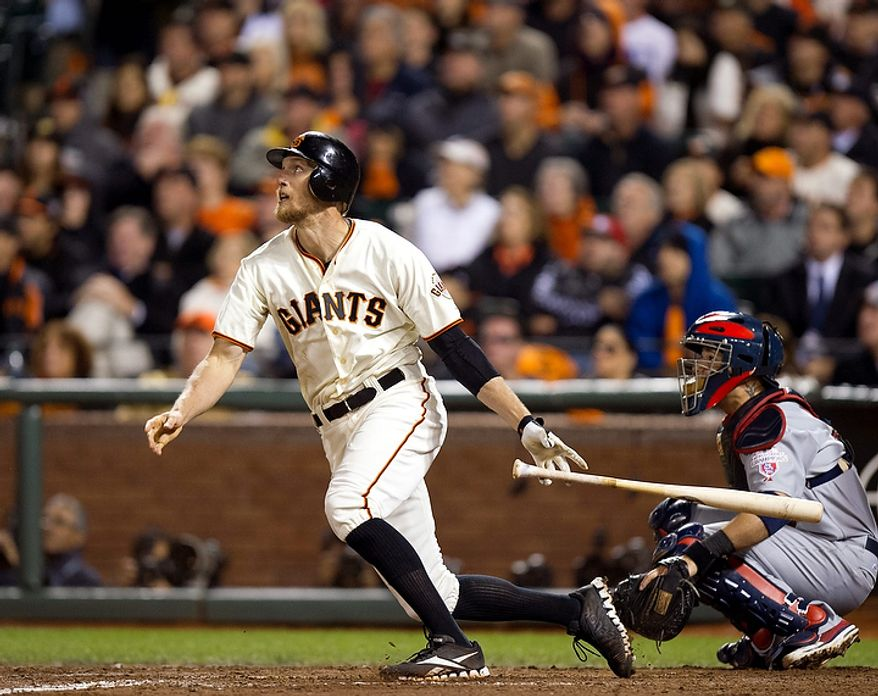 San Francisco Giants right fielder Hunter Pence (8) watches his ball fly deep to right during Game 1 of baseball's National League championship series against the St. Louis Cardinals  on Sunday, Oct. 14, 2012, in San Francisco. (AP Photo/The Sacramento Bee, Paul Kitagaki Jr.)