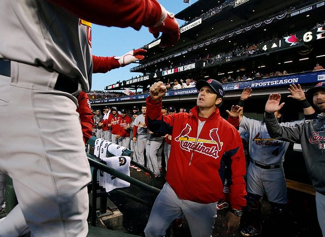St. Louis Cardinals manager Mike Matheny congratulates Carlos Beltran, foreground left, as he returns to the dugout after hitting a two-run home run during the fourth inning in Game 1 of baseball's National League championship series against the San Francisco Giants Sunday, Oct. 14, 2012, in San Francisco. The Cardinals won 6-4. (AP Photo/St. Louis Post-Dispatch, Chris Lee)