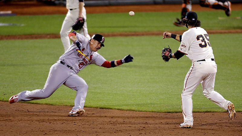 St. Louis Cardinals' Allen Craig (21) is out at second as San Francisco Giants' Brandon Crawford (35) turns a double play during the fifth inning of Game 1 of baseball's National League championship series Sunday, Oct. 14, 2012, in San Francisco. (AP Photo/Mark Humphrey)