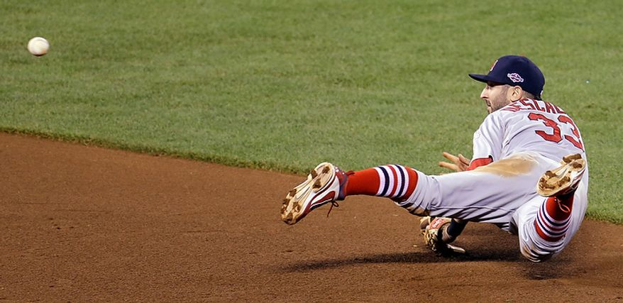 St. Louis Cardinals' Daniel Descalso (33) makes a play on a ball hit by San Francisco Giants' Angel Pagan during the fourth inning of Game 1 of baseball's National League championship series Sunday, Oct. 14, 2012, in San Francisco. (AP Photo/Eric Risberg)