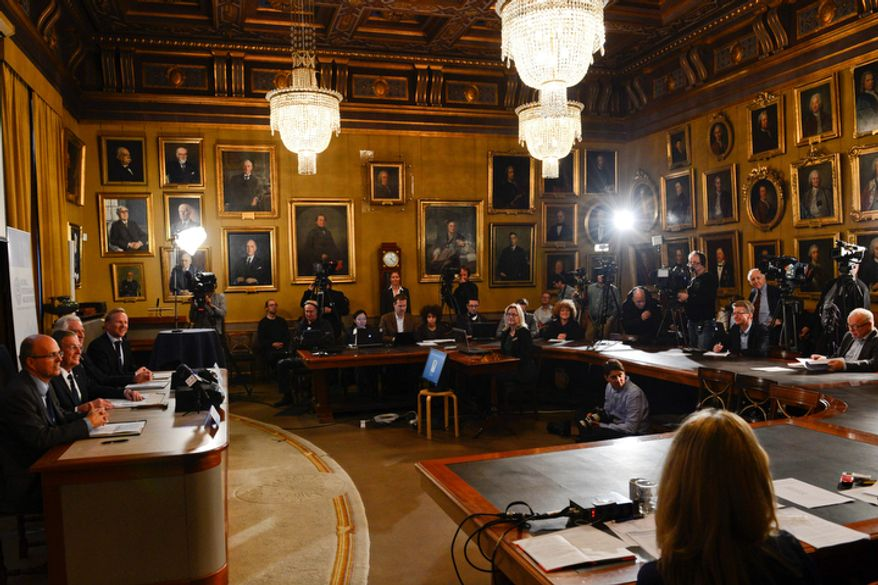 "Journalists listen as (from left) Per Krusell, Staffan Normark, Peter Gardenfors and Tore Ellingsen of the Swedish Royal Academy of Sciences announce the winners of the Nobel Memorial Prize in Economic Sciences in Stockholm on Monday, Oct. 15, 2012. Alvin Roth of Harvard University and Lloyd Shapley of the University of California at Los Angeles won the prize ""for the theory of stable allocations and the practice of market design.""  (AP Photo/Scanpix Sweden, Henrik Montgomery)"
