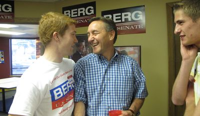 **FILE** U.S. Rep. Rick Berg of North Dakota, a Republican candidate for Senate, shakes hands with supporter Nate Todd on June 12, 2012, during a reception at Berg's Fargo headquarters for the primary election. (Associated Press)