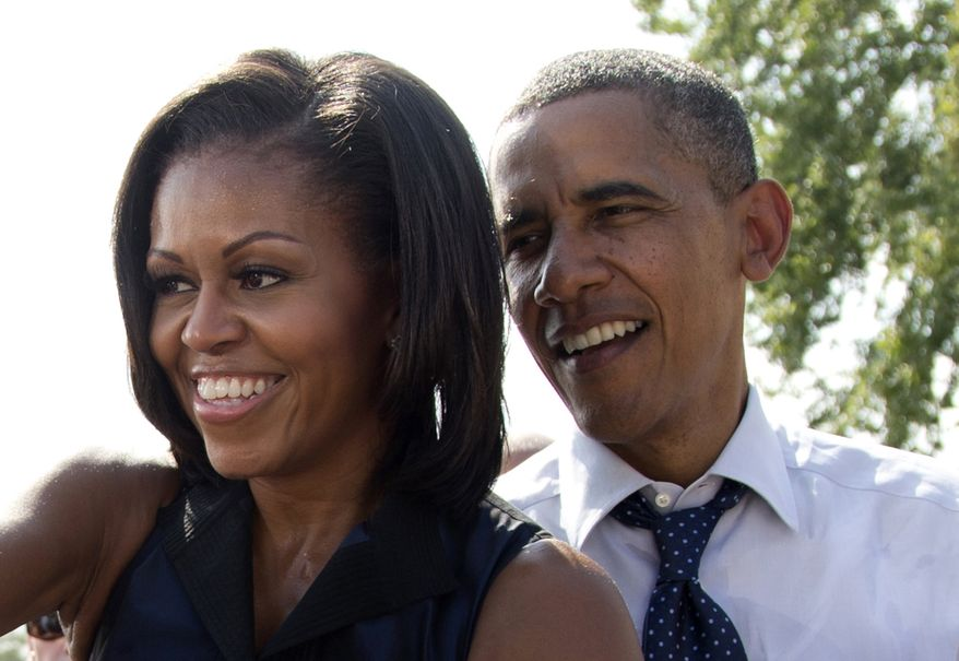 **FILE** President Obama and first lady Michelle Obama greet supporters Sept. 7, 2012, in Portsmouth, N.H. (Associated Press)