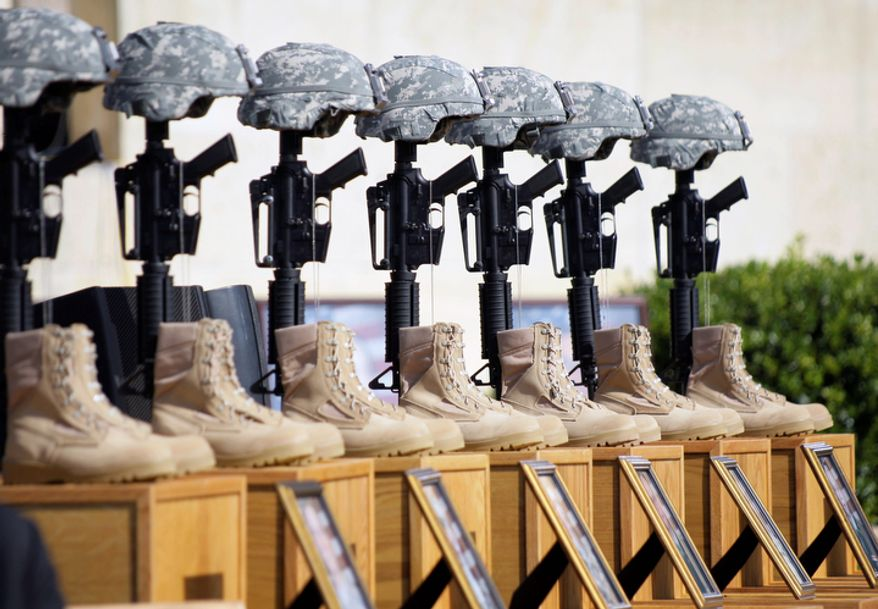 In this Nov. 10, 2009, file photo, a memorial to victims of the Fort Hood shooting is shown before the start of a memorial service, to be attended by President Barack Obama, at Fort Hood, Texas. Osama bin Laden is dead and there hasnít been a successful attack by al-Qaida-inspired extremists on U.S. soil since the deadly shooting rampage in Fort Hood, Texas, in 2009. But the danger of terrorism remains a reality for Americans, as seen in the attack in Libya in September that killed U.S. Ambassador Chris Stevens and three other Americans. (AP Photo/Donna McWilliam, File)