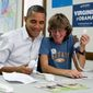 President Obama, making phone calls Sunday to campaign volunteers with Suzanne Stern in Williamsburg, Va., is hearing accusations from the GOP that his administration is putting politics ahead of the safety of American diplomats. (Associated Press)