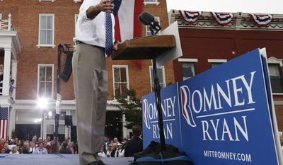 Republican presidential candidate and former Massachusetts Gov. Mitt Romney campaigns at The Golden Lamb restaurant in Lebanon, Ohio, Saturday, Oct. 13, 2012. (AP Photo/Charles Dharapak)