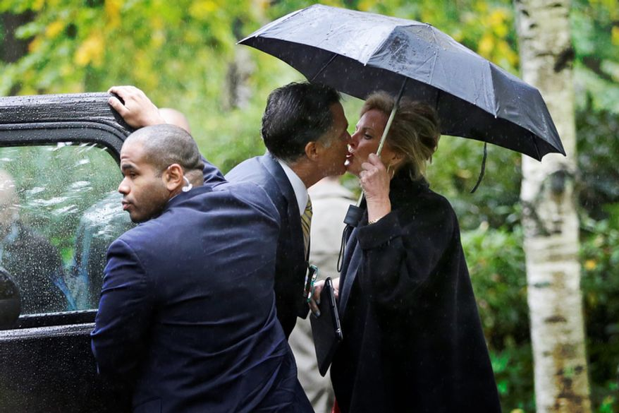 Republican presidential candidate Mitt Romney kisses his wife, Ann, as he leaves the Church of Jesus Christ of Latter-day Saints in Belmont, Mass. on Oct. 14, 2012. (Associated Press)