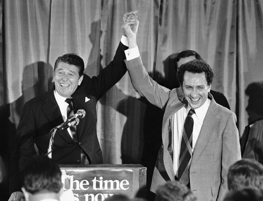 **FILE** Republican presidential candidate Ronald Reagan holds up U.S. Senate candidate Arlen Specter's hand at fund-raising party for Specter in Philadelphia on Aug. 19, 1980. (Associated Press)