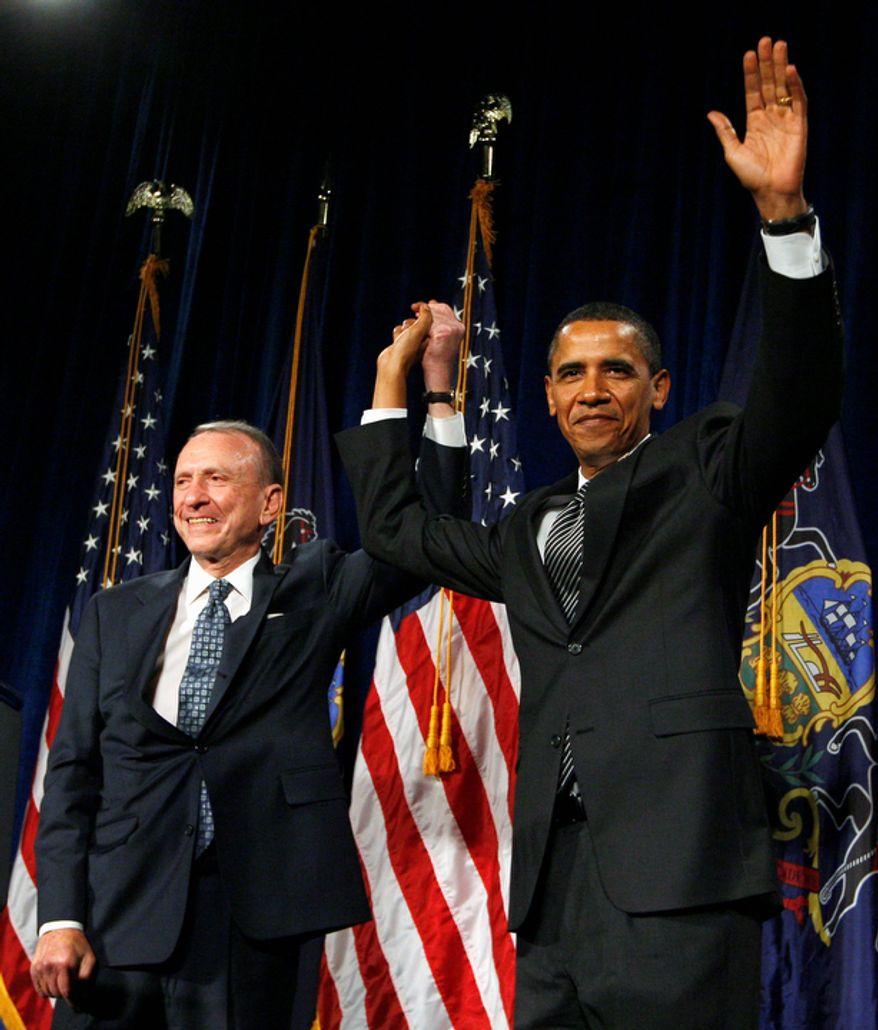 **FILE** President Obama arrives Sept. 15, 2009, at a fundraising event for Sen. Arlen Specter, Pennsylvania Democrat, at the Pennsylvania Convention Center in Philadelphia. (Associated Press)