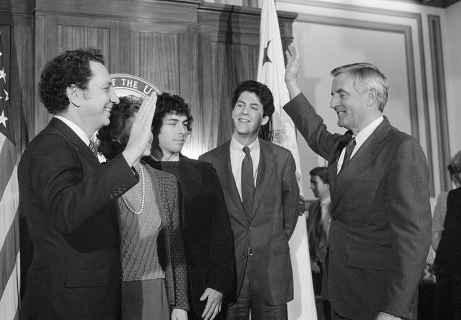 **FILE** Vice President Walter F. Mondale re-enacts the swearing in of Sen. Arlen Specter, Pennsylvania Republican, at the Capitol in Washington on Jan. 6, 1981. (Associated Press)