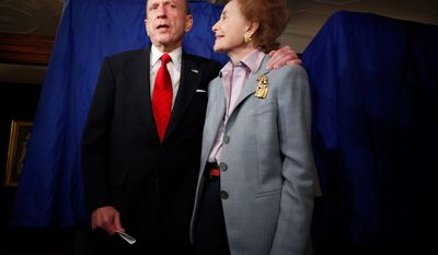 **FILE** Sen. Arlen Specter, Pennsylvania Democrat, stands May 18, 2010, with his wife, Joan, after voting in Philadelphia. (Associated Press)