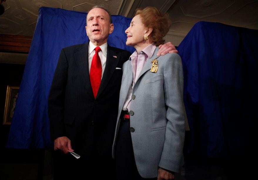 **FILE** Sen. Arlen Specter, Pennsylvania Democrat, stands May 18, 2010, with his wife, Joan, after voting in Philadelphia. (Associated Press)