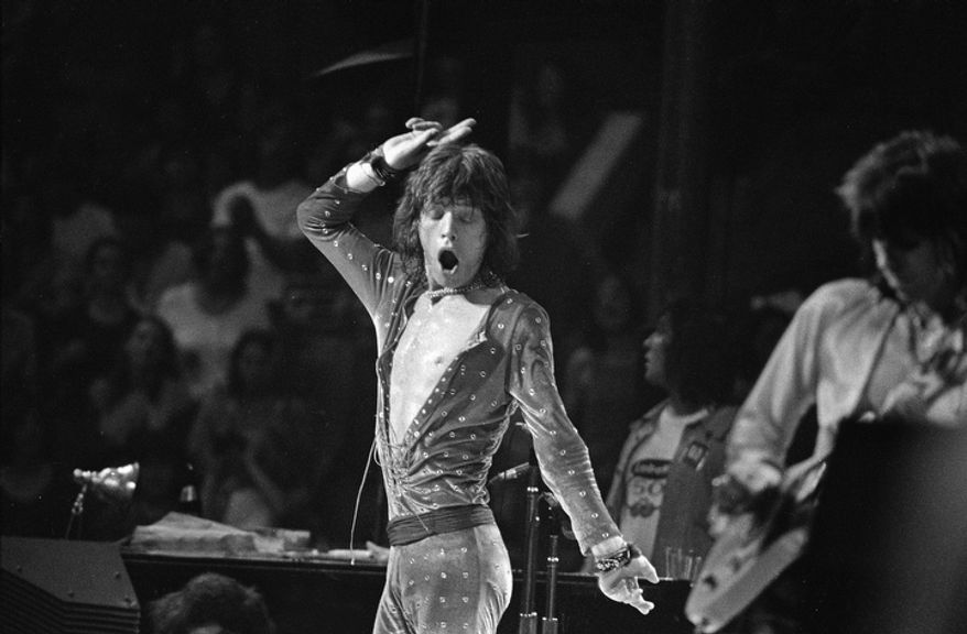 Mick Jagger of the Rolling Stones is resplendent in a rhinestone-studded outfit, entertaining a capacity audience of 15, 509 at the Boston Garden, in Boston, Mass., July 20, 1972.  (AP Photo)