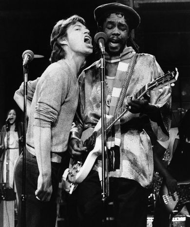 """In this Dec. 16, 1978 file photo, Mick Jagger, left, of the Rolling Stones, joins Jamaica's reggae musician Peter Tosh during a rehearsal for NBC's ?Saturday Night Live,"""" program in New York. For his musical contributions, Tosh's daughter, Niambe, received on Monday, Oct. 15, 2012, the posthumous """"Order of Merit"""" for her father, during the island's annual national heroes ceremony. Tosh, a founding member of the reggae band The Wailers along Bob Marley and Bunny Wailer, was killed in 1987 at age 42 by robbers who broke into his Jamaican home. (AP Photo/File)"""