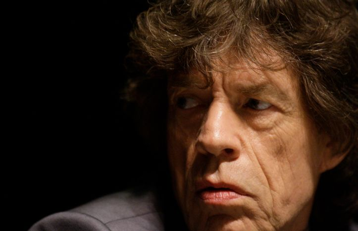 """Musician Mick Jagger attends the screening of """"Stones in Exile"""", at the 63rd international film festival, in Cannes, southern France, Wednesday, May 19, 2010. (AP Photo/Joel Ryan)"""