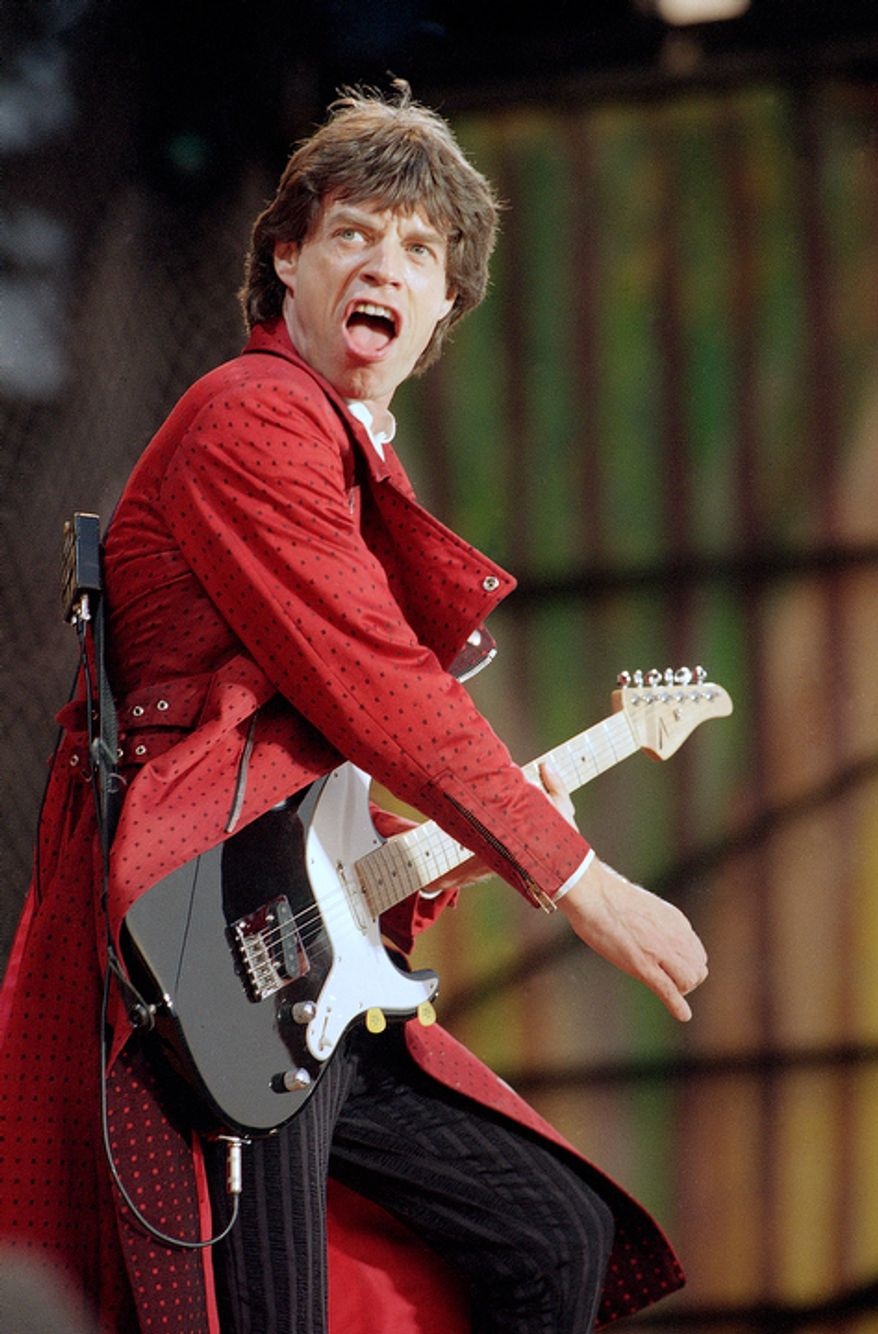 This May 23, 1990 file photo shows Mick Jagger from The Rolling Stones during a performance in Hanover, West Germany. Thursday, July 12, 2012, marks 50 years since Jagger played his first gig with the band. Now in their late 60s and early 70s, the band members are celebrating the anniversary by attending a retrospective photo exhibition at London's Somerset House and looking to the future by rehearsing for new gigs. (AP Photo/Claus Eckert, file)