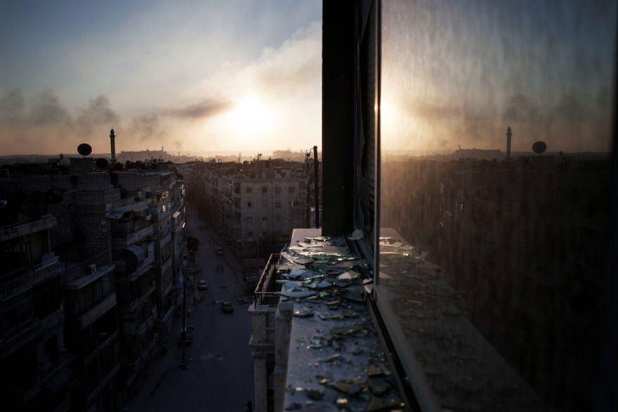 Smoke rises from a damaged building in Aleppo, Syria, on Saturday, Oct. 13, 2012. (AP Photo/Manu Brabo)