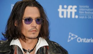 """Actor Johnny Depp's new book publishing venture will bring """"The Unraveled Tales of Bob Dylan"""" to readers. (Associated Press)"""