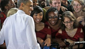 **FILE** President Obama stops for a photo with members of the Vox Harmonia Visual and Performing Arts Academy Salem High School during a Sept. 27, 2012, campaign event at Farm Bureau Live in Virginia Beach, Va. (Associated Press)