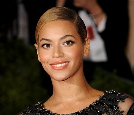 **FILE** Beyonce Knowles attends the Metropolitan Museum of Art Costume Institute gala benefit, celebrating Elsa Schiaparelli and Miuccia Prada, in New York on May 7, 2012. (Associated Press)