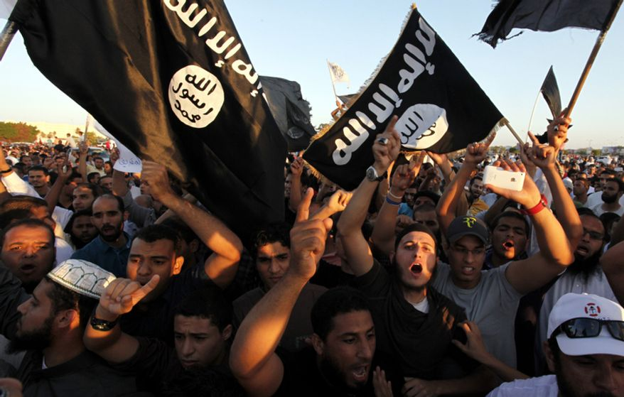 **FILE** Libyan followers of Ansar al-Shariah Brigades and other Islamic militias hold a demonstration Sept. 21, 2012, in Benghazi, Libya against a film and a cartoon denigrating the Prophet Muhammad. (Associated Press)