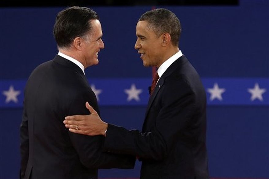 Republican presidential nominee Mitt Romney and President Barack Obama shake hands during the second presidential debate at Hofstra University, Tuesday, Oct. 16, 2012, in Hempstead, N.Y. (AP Photo/Charlie Neibergall)
