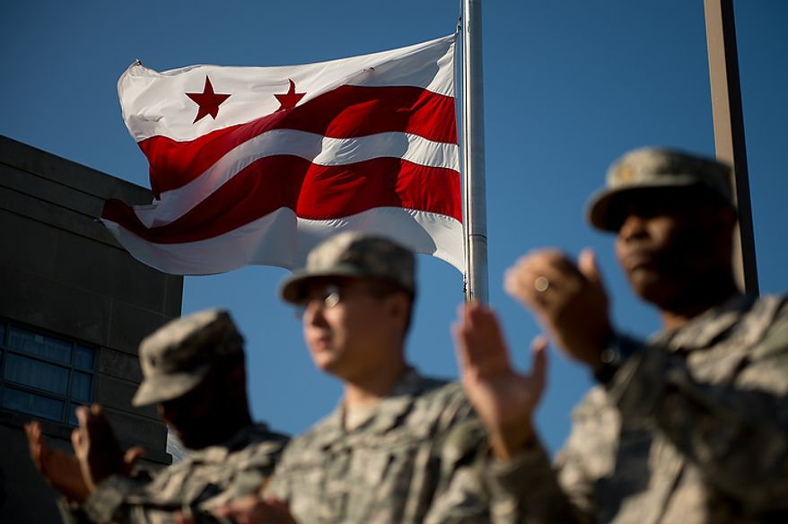 Soldiers applaud as 70 D.C. Army National Guard soldiers with the 273rd military police company returning from Bagram Air Base, Afghanistan are welcomed home at a ceremony held in front of the D.C. Armory, Washington, D.C., Tuesday, October 16, 2012. (Andrew Harnik/The Washington Times)