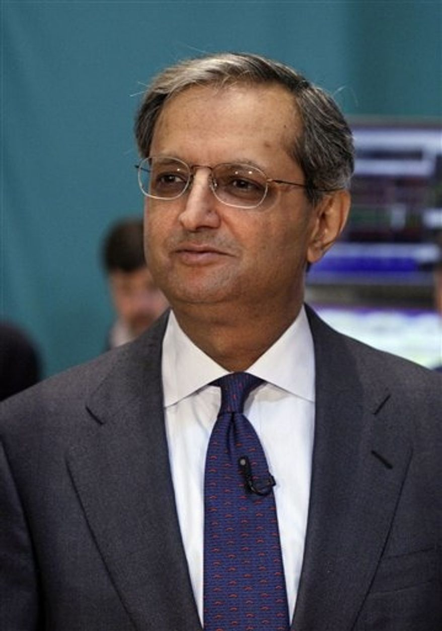 ** FILE ** In a Monday, June 18, 2012, file photo, Citigroup CEO Vikram Pandit prepares for a television interview on the floor of the New York Stock Exchange, after he rang the opening bell. (AP Photo/Richard Drew, File)