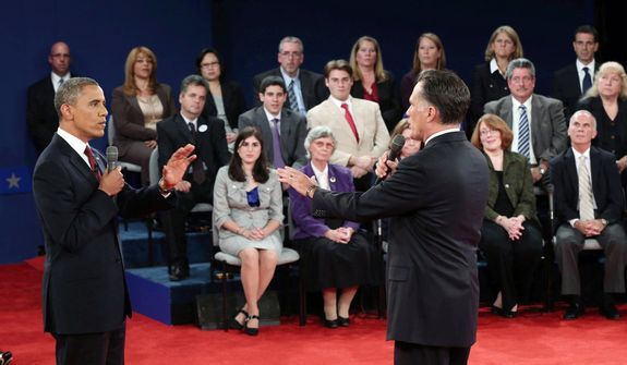 President Barack Obama, left, and Republican presidential nominee Mitt Romney confront each other during the second presidential debate at Hofstra University, Tuesday, Oct. 16, 2012, in Hempstead, N.Y.  (AP Photo/Pool-Win McNamee)