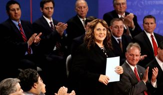 Moderator Candy Crowley is introduced before the second presidential debate at Hofstra University. (AP Photo/Charlie Neibergall)