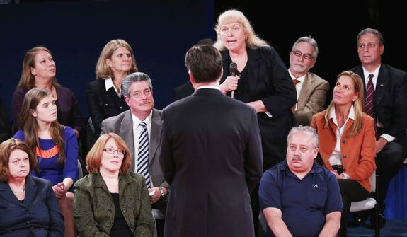 A member of the audience asks Republican presidential nominee Mitt Romney a question during the second presidential debate with President Barack Obama at Hofstra University. (AP Photo/Pool-Win McNamee)