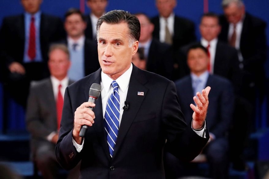 Republican presidential nominee Mitt Romney answers a question during the second presidential debate. (AP Photo/Pool, Rick Wilking)