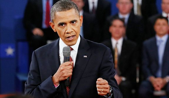 President Barack Obama answers a question during the second presidential debate. (AP Photo/Pool, Rick Wilking)